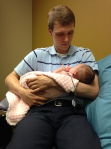 Daddy and Nora at the audiologist